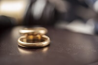 Wedding rings on a table during uncontested divorce